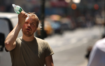 Heat waves not only make it seem difficult to function, they can be deadly as well. This man tried to cool himself with a water bottle during a 2008 heat wave in New York City.