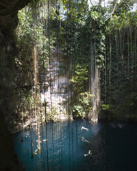 Swimmers kick back in a Mexican cenote.