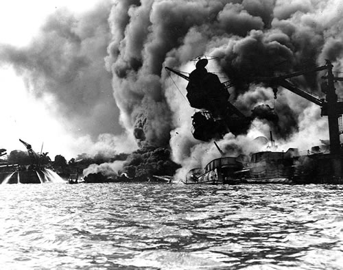USS Arizona burning at Pearl Harbor.