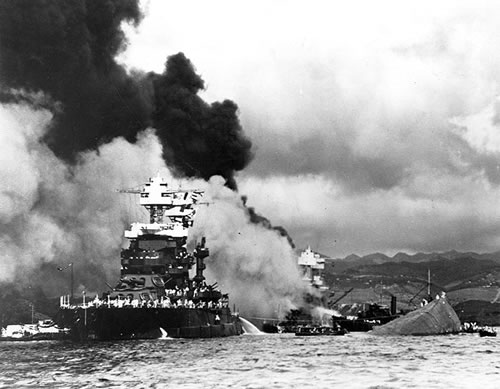 USS Maryland and the capsized USS Oklahoma.