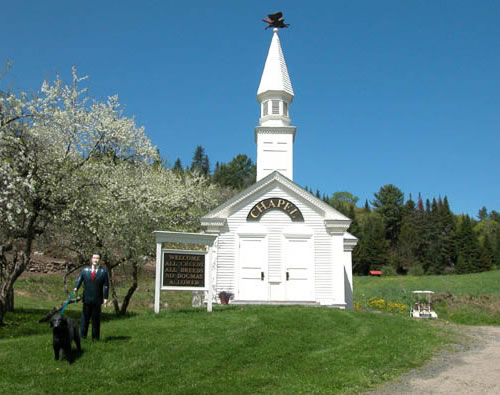 Stephen Huneck's Dog Chapel, complete with statue of a man walking his dog